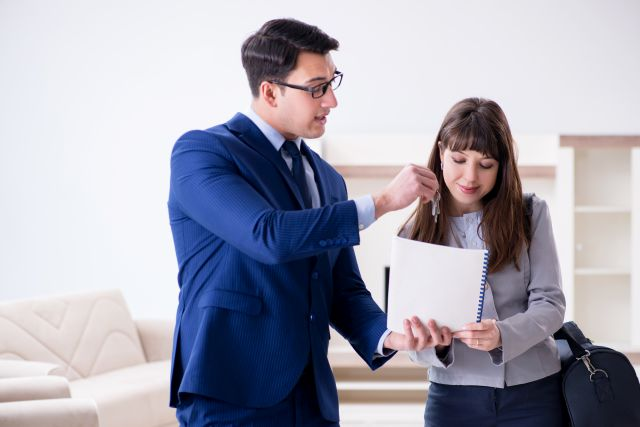 Real estate agent showing new apartment to owner